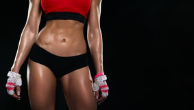 The body of young athletic girl on a dark background Stock Image