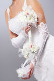 Body of a young bride in a white dress Royalty Free Stock Image
