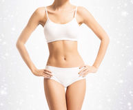 Body of a young and fit woman in white sporty lingerie Stock Photo