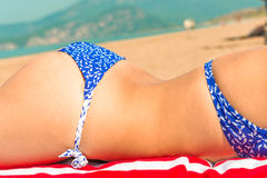 Body of a young girl in a swimsuit on the beach Royalty Free Stock Photo