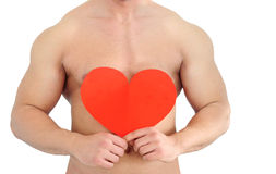Body of young man holding heart Royalty Free Stock Photography