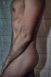Body of a young man in the shower Stock Photography
