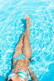 Body of young woman in the crystal-clear water Stock Images