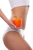 Body of a young woman holding a fresh paprika Stock Photos