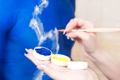 Bodyart artist making initial preparation Stock Photo