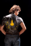Bodyart/body-art. Handsome man with body art on his back isolated on black background Royalty Free Stock Photo