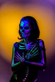 Bodyart di scheletro con blacklight Fotografie Stock