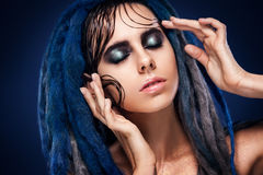Bodyart model girl portrait with colorful paint make up. woman bright color makeup. Closeup of vogue style lady Stock Photography