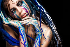 Bodyart model girl portrait with colorful paint make up. Sexy woman bright color makeup. Closeup of vogue style lady. Fashion model girl portrait with colorful Royalty Free Stock Photo