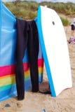Bodyboard y wetsuit Foto de archivo libre de regalías