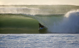 Bodyboarder dans l'onde Photo libre de droits