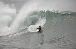 Bodyboarder in der Welle Stockbilder