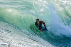 Bodyboarder en la acción Imagen de archivo