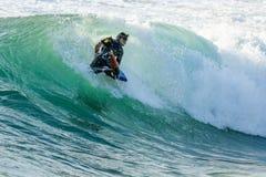 Bodyboarder i handling Royaltyfria Foton