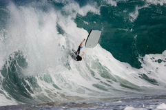 Bodyboarder wischt weg Stockfotos