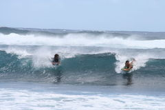 Bodyboarding - boys riding turquoise waves Royalty Free Stock Images