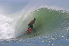 Bodyboarding Surfing a Tube Wave in Hawaii. A boogie boarder rides a tubing wave in Hawaii Royalty Free Stock Photo
