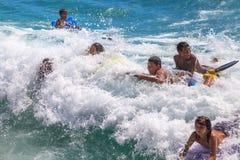 Bodyboarding water sport. Waikiki, Oahu, Hawaii - August 27, 2016: the funny and most popular water sports of Waikiki Beach in Honolulu: the boogie boarding or Stock Photo