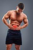 Bodybuilder żołądka obolałość Zdjęcia Royalty Free