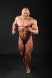 bodybuilder στούντιο τρεξιμάτων εσωτερικών άντυτο Στοκ φωτογραφία με δικαίωμα ελεύθερης χρήσης