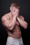 Bodybuilder. Muscled male model posing in studio Royalty Free Stock Images
