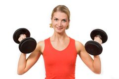 Bodybuilder. Picture of a nice blond girl with heavy dumbbels Royalty Free Stock Photos
