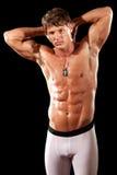 Bodybuilder. Male bodybuilder. Studio shot over black Stock Photo