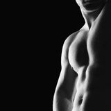 Bodybuilder. Silhouette of young athlete bodybuilder man on black Stock Photography