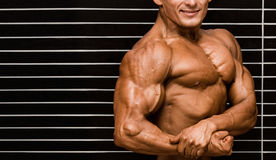 Bodybuilder. In front of wall royalty free stock images