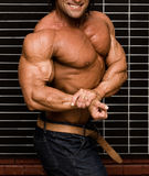 Bodybuilder. In front of wall stock photography
