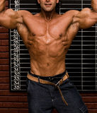Bodybuilder. In front of wall stock photos