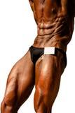 Bodybuilder abdominal thigh pose Royalty Free Stock Image
