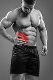 Bodybuilder Appendicitis attack. Muscular man having appendicitis attack. Acute abdomen pain. Glowing red area Stock Image