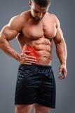 Bodybuilder Appendicitis attack. Muscular man having appendicitis attack. Acute abdomen pain. Glowing red area Stock Images