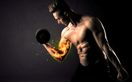 Bodybuilder athlete lifting weight with fire explode arm concept Stock Images