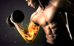 Bodybuilder athlete lifting weight with fire explode arm concept Royalty Free Stock Photos