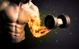 Bodybuilder athlete lifting weight with fire explode arm concept Stock Image