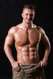 Bodybuilder in a bag Stock Images