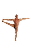 Bodybuilder Balancing. Fit Male Model Balanced On White Isolated Background Stock Photography