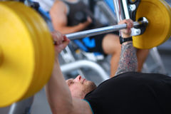 Bodybuilder with barbell in gym Royalty Free Stock Photography