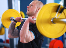 Bodybuilder with barbell in gym Royalty Free Stock Photo