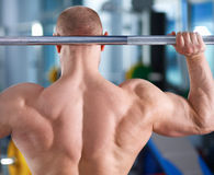 Bodybuilder with barbell in gym Royalty Free Stock Images