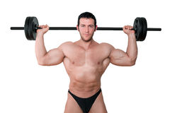 Bodybuilder with barbell isolated. Royalty Free Stock Image