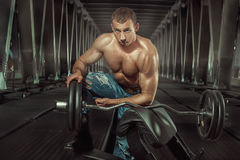 Bodybuilder with a barbell. Royalty Free Stock Photo