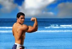 Bodybuilder on the beach stock image
