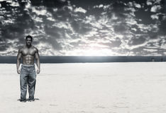 Bodybuilder on Beach Royalty Free Stock Photos