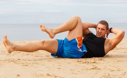 Bodybuilder on the beach Stock Photos