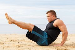 Bodybuilder on the beach Royalty Free Stock Photography