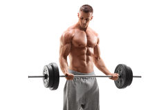 Bodybuilder beau s'exerçant avec un barbell Photographie stock libre de droits