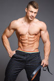Bodybuilder. The beautiful and strong young guy Stock Photo
